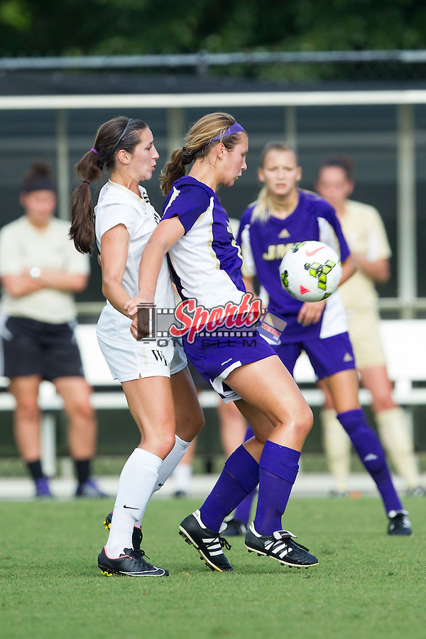 Nicole Caston (8) of the James Madison Dukes uses her body to keep Kendall Fischlein (23) of the Wake Forest Demon Deacons from the ball at Spry Soccer Stadium on August 29, 2014 in Winston-Salem, North Carolina.  The Dukes defeated the Demon Deacons 2-1.   (Brian Westerholt/Sports On Film)