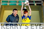 Feale Rangers captain Conor Sweeney accepts the Sylvie Mason Memorial Cup from Reggie Griffin having defeated  South Kerry in the U14 County District Football Championship Cup final.