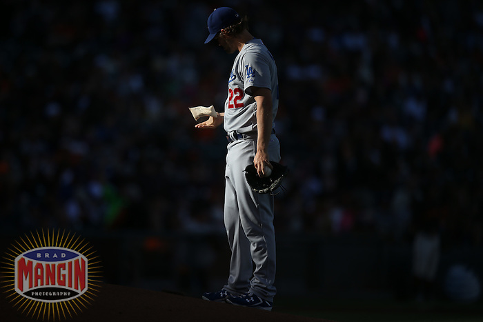 SAN FRANCISCO, CA - JULY 26:  Clayton Kershaw #22 of the Los Angeles Dodgers puts resin on his hand during the game against the San Francisco Giants at AT&T Park on Saturday, July 26, 2014 in San Francisco, California. Photo by Brad Mangin