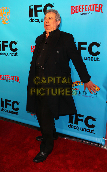 TERRY JONES .Special IFC and BAFTA screening of the IFC Documentary of Monty Python: Almost The Truth (The Lawyer's Cut), New York, NY, USA..October 15th, 2009.full length coat jacket hands leaning bending funny black .CAP/ADM/PZ.©Paul Zimmerman/AdMedia/Capital Pictures.