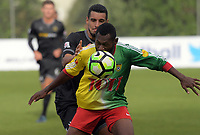 Nigel Dabinyaba (Lae City Dwellers) holds off Mario Barcia during the 2018 OFC Champions League Quarterfinal between Team Wellington and Lae City Dwellers FC at David Farrington Park in Wellington, New Zealand on Saturday, 7 April 2018. Photo: Dave Lintott / lintottphoto.co.nz