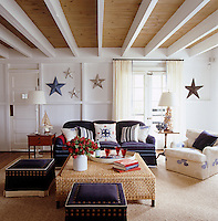 A selection of star sculptures adorn the walls of this beamed ceiling sitting room.