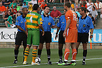 14 May 2010: Referee Jose Carlos Rivero talks with team captains Tampa Bay's Julian Valentin (4) and Carolina's Mark Schulte (13) before the game. The FC Tampa Bay Rowdies defeated the Carolina RailHawks 2-1 at WakeMed Stadium in Cary, North Carolina in a regular season U.S. Soccer Division-2 soccer game.