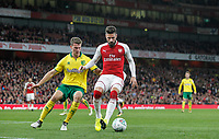 Olivier Giroud of Arsenal holds off Christoph Zimmermann of Norwich City during the Carabao Cup match between Arsenal and Norwich City at the Emirates Stadium, London, England on 24 October 2017. Photo by Carlton Myrie.