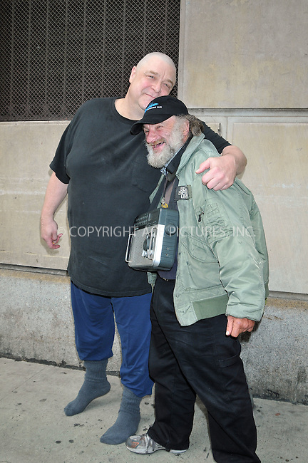 WWW.ACEPIXS.COM . . . . . ....June 16 2009, New York City....Actor John Goodman (with Radioman )spotted in the theatre district of Manhattan taking a break from play rehersals on June 16, 2009 in New York City.....Please byline: AJ SOKALNER - ACEPIXS.COM.. . . . . . ..Ace Pictures, Inc:  ..tel: (212) 243 8787 or (646) 769 0430..e-mail: info@acepixs.com..web: http://www.acepixs.com