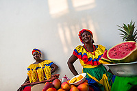 Afro-Colombian women, dressed in the traditional 'palenquera' costume, sell fruits on the street of Cartagena, Colombia, 16 December 2017. With the peace agreement, ending a 52-year civil conflict and promising political stability, together with rapid economic growth and unexploited tourism potential, Colombia has truly become a holiday destination. Cartagena, a UNESCO World Heritage site on the tropical Caribbean coast, plays the primary role in Colombia's tourism renaissance. The historic sites from the Spanish colonial times are being restored, private investments are visible throughout the city and an increased number of local people benefit from the boom of the travel related services.