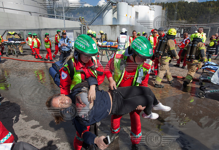 Paramedics tend to &quot;victims&quot; and firefighters put out a fire in an oil facility. HarbourEx15, a field training exercise with scenarios connected to operations in the harbor April 27th &ndash; 29th 2015.<br /> <br /> The scenario of the exercise is a major accident on Sydhavna /Sjursj&oslash;ya area of Oslo, and will involve rescue and emergency response agencies from tactical to strategic level. (photo: Fredrik Naumann/Felix Features)