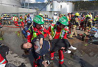 Paramedics tend to &quot;victims&quot; and firefighters put out a fire in an oil facility. HarbourEx15, a field training exercise with scenarios connected to operations in the harbor April 27th &ndash; 29th 2015.<br />