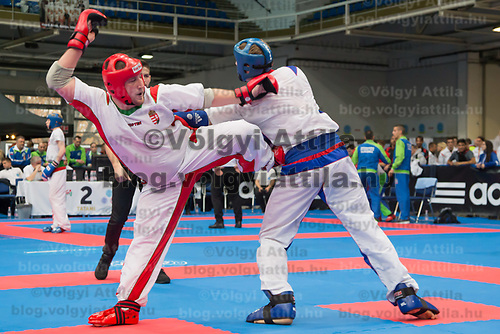 Gold medalist Krisztian Jaroszkievicz (L) of Hungary and silver medalist Alexander Bobrov (R) of Russia fight in the 1 PF 053 S M +94 kg final at the WAKO (World Association of Kickboxing Organizations) World Kick-boxing Championships in Budapest, Hungary on Nov. 10, 2017. ATTILA VOLGYI