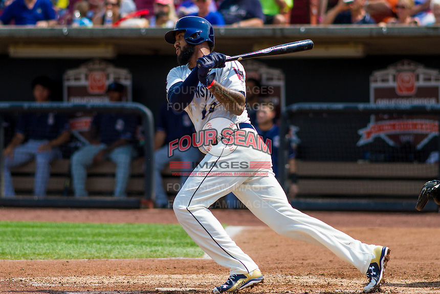 Milwaukee Brewers outfielder Domingo Santana (16) swings at a pitch during a rehab appearance with the Wisconsin Timber Rattlers in a Midwest League game against the Lake County Captains on July 24, 2016 at Fox Cities Stadium in Appleton, Wisconsin. Lake County defeated Wisconsin 6-2. (Brad Krause/Four Seam Images)