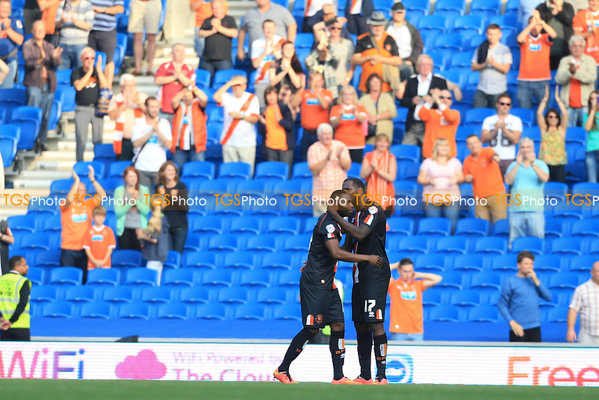 Ishmael Miller and Francois Zoko of Blackpool celebrate their point in front of their travelling fans - Brighton & Hove Albion vs Blackpool - Sky Bet Championship Football at the American Express Community Stadium, Falmer, Brighton - 20/09/14 - MANDATORY CREDIT: Simon Roe/TGSPHOTO - Self billing applies where appropriate - contact@tgsphoto.co.uk - NO UNPAID USE