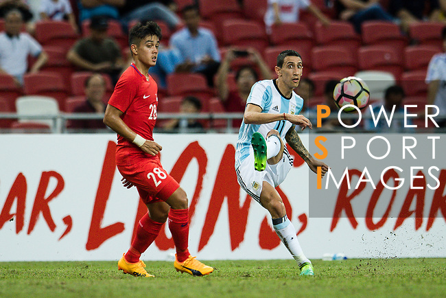 Angel Di Maria of Argentina (R) looks to bring the ball down during the International Test match between Argentina and Singapore at National Stadium on June 13, 2017 in Singapore. Photo by Marcio Rodrigo Machado / Power Sport Images