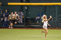 Unidentified female fan runs onto the field during the eighth inning of the 2013 Men's College World Series Final on June 25, 2013 at TD Ameritrade Park in Omaha, Nebraska. The UCLA Bruins defeated the Mississippi State Bulldogs 8-0, winning the National Championship. (Andrew Woolley/Four Seam Images)