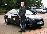 Pictured: Dr Peter O'Keefe with his Skoda Uber taxi in Cardiff Bay. Tuesday 05 September 2017<br /> Re: A heart surgeon who has accepted a cash settlement from the health board he accused of sacking him unfairly is now working as an Uber taxi driver.<br /> Peter O&rsquo;Keefe, was working as a consultant cardiac surgeon at the University Hospital of Wales in Cardiff and was suspended for more than three years. Health workers accused him of bullying and harassing them before being dismissed.<br /> An employment tribunal case, which was due to begin yesterday, was called off after Cardiff &amp; Vale University Health Board reached a settlement agreement with him.