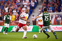 Thierry Henry (14) of the New York Red Bulls and Kosuke Kimura (15) of the Portland Timbers. The New York Red Bulls  defeated the Portland Timbers 3-2 during a Major League Soccer (MLS) match at Red Bull Arena in Harrison, NJ, on August 19, 2012.