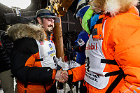 First place winner Pete Kaiser congratulates second place finisher Joar Leifseth Ulsom at the Nome finish line shortly after winning the 2019 Iditarod Trail Sled Dog Race. Pete's winning time is 9 days 12 hours 39 minutes and 6 seconds<br /> <br /> Photo by Jeff Schultz/  (C) 2019  ALL RIGHTS RESERVED