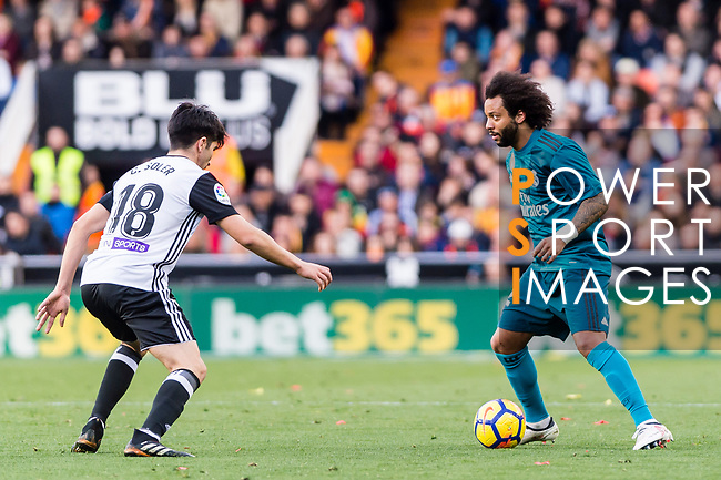 Marcelo Vieira Da Silva of Real Madrid (R) fights for the ball with Carlos Soler Barragan of Valencia CF (L) during the La Liga 2017-18 match between Valencia CF and Real Madrid at Estadio de Mestalla  on 27 January 2018 in Valencia, Spain. Photo by Maria Jose Segovia Carmona / Power Sport Images
