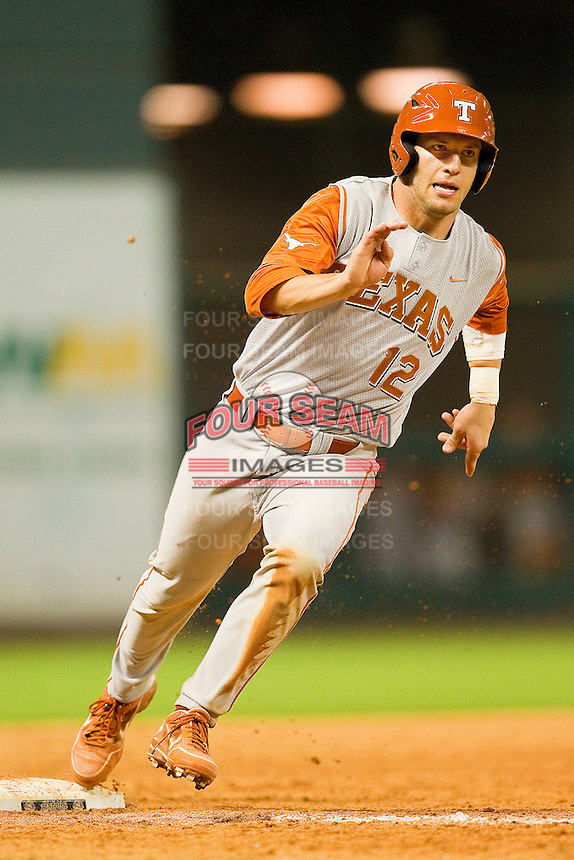Jacob Felts #12 of the Texas Longhorns rounds third base during the game against the Tennessee Volunteers at Minute Maid Park on March 3, 2012 in Houston, Texas.  The Volunteers defeated the Longhorns 5-4.  (Brian Westerholt/Four Seam Images)