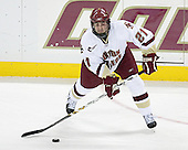 Benn Ferriero 21 of Boston College passes the puck. The Eagles of Boston College defeated the Falcons of Bowling Green State University 5-1 on Saturday, October 21, 2006, at Kelley Rink of Conte Forum in Chestnut Hill, Massachusetts.<br />