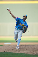 Myrtle Beach Pelicans relief pitcher Jasvir Rakkar (21) in action against the Winston-Salem Dash at BB&T Ballpark on May 9, 2015 in Winston-Salem, North Carolina.  The Pelicans defeated the Dash 3-2 in 10 innings in the first game of a double-header.  (Brian Westerholt/Four Seam Images)