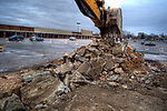 Workers demolish a closed car wash at the corner of a parking lot where Wal-Mart will build a new store in a strip shopping center in Westerville, OH.