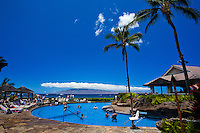 Resort swimming pool on the Kaanapali Coast of Maui, with Molokai in the distance