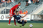 09 July 2014: Dallas' Blas Perez (PAN) (left) fouls Carolina's Daniel Scott (right). The Carolina RailHawks of the North American Soccer League played FC Dallas of Major League Soccer at WakeMed Stadium in Cary, North Carolina in the quarterfinals of the 2014 Lamar Hunt U.S. Open Cup soccer tournament. FC Dallas won the game 5-2.