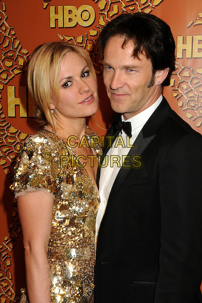 ANNA PAQUIN & STEPHEN MOYER.HBO's 2010 67th Golden Globe Awards Post Party held at the Beverly Hilton Hotel, Beverly Hills, California, USA. .January 17th, 2009 .globes half length dress black tuxedo couple gold sequins sequined plunging neckline cleavage.CAP/ADM/BP.©Byron Purvis/Admedia/Capital Pictures