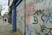 Graffiti on a shopfront on Cricklewood Broadway, Brent, London.