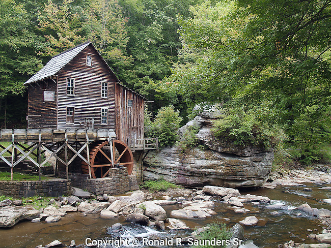 The Glade Creek Grist Mill is a new mill that was completed in 1976 at Babcock. Fully operable, this mill was built as a <br /> re-creation of one which once ground grain on Glade Creek long before Babcock became a state park. Known as Cooper's Mill, it stood on the present location of the park's administration building.<br /> (5)