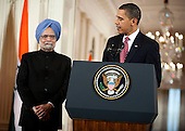 Washington, DC - November 24, 2009 -- United States President Barack Obama speaks as Manmohan Singh, left, India's prime minister, watches during an arrival ceremony at the White House in Washington, D.C., U.S., on Tuesday, November 24, 2009.  .Credit: Joshua Roberts - Pool via CNP