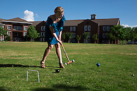 Sophomore chemical engineering major Olivia C. Williams of Friendswood, Texas, plays in a croquet tournament in the courtyard near Griffis Hall. Annually sponsored by the university's Judy and Bobby Shackouls Honors College, the event brings together students who have participated or are planning to participate in the Honors Study Abroad summer course at the University of Oxford in England. Williams will be participating in the Oxford program this summer.<br />