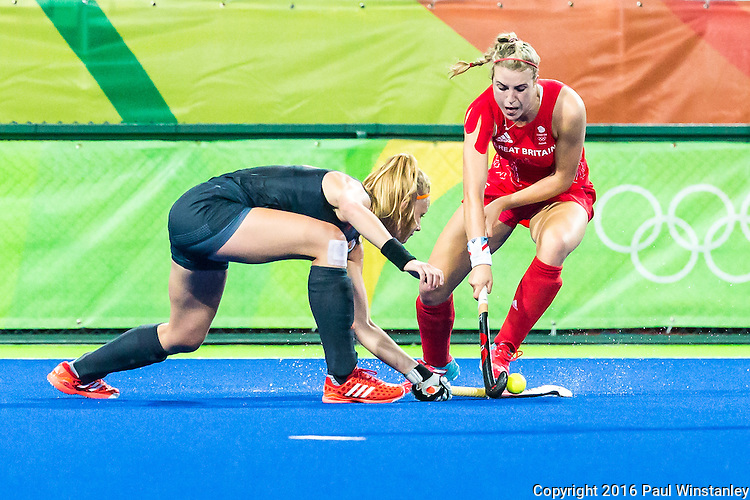 Lily Owsley #26 of Great Britain is tackled during Netherlands vs Great Britain in the gold medal final at the Rio 2016 Olympics at the Olympic Hockey Centre in Rio de Janeiro, Brazil.