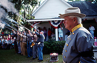 After a prayer muskets are fired to honor a relative who was a Confederate soldier. Up to 1000 relatives gather at the homestead of the Tatum family for a reunion and three day celebration. On the first day, famly members arrive in costume and uniforms for a skit and reenactment of a skirmish.