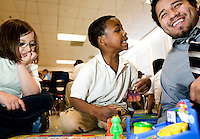 Teaching Assistant Daniel Cruz (cq, right) laughs with Cameron Hampton (cq, middle, age 8) and Cordelia Easton (cq, age 7) during the CLIMB program, Changing Lives, Improving Minds, and Bodies, tutor and play with students at Lipscomb Elementary School in East Dallas, Texas, Tuesday, March 25, 2008. The after school program was developed through the Wilkinson Center...PHOTO/ MATT NAGER
