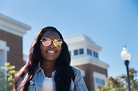 Student with sunglasses walking near Colvard Union.<br />  (photo by Megan Bean / &copy; Mississippi State University)