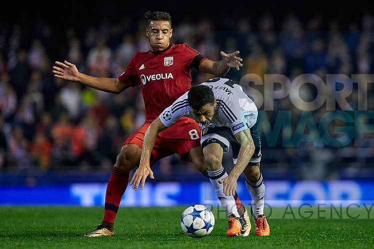 Corentin Tolisso (L) of Olympique Lyonnais competes for the ball with Javi Fuego of Valencia CF - UEFA Champions League Group H - Valencia CF vs Olympique Lyonnais - Mestalla Stadium - Valencia- Spain - 09th December 2015 - Pic David Aliaga/Sportimage