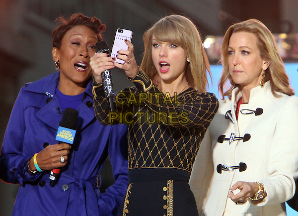 NEW YORK, NY - OCTOBER 30: Taylor Swift takes a selfie with the hosts of Good Morning America after performing in front of a live crowd in New York City on October 30, 2014.  <br /> CAP/MPI/RW<br /> &copy;RW/ MediaPunch/Capital Pictures