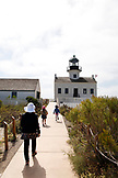 USA, California, San Diego, a family walks out to the Point Cabrillo Light Station, a California State Historic Park