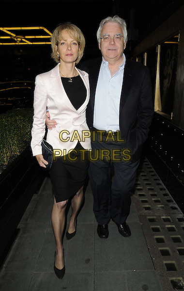 Jenny Seagrove & Bill Kenwright.departed after the 'Cabaret' press night performance, Savoy Theatre, The Strand, London, England..October 9th, 2012.full length white shirt blue suit black dress blazer couple arm around waist  .CAP/CAN.©Can Nguyen/Capital Pictures.