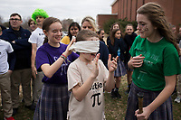 NWA Democrat-Gazette/CHARLIE KAIJO Aubrey Holloway, 14, ties a blindfold on Christopher Haviland, 13, for a pi&Atilde;&plusmn;ata game during a Pi Day celebration, Thursday, March 13, 2019 at St. Vincent de Paul Catholic School in Rogers. <br /><br />Students at St. Vincent de Paul Catholic School celebrates Pi Day with a pie eating contest, games and a pi&Atilde;&plusmn;ata. Pi Day is an annual celebration of the mathematical constant &Iuml;&euro;. Pi Day is observed on March 14 since 3, 1, and 4 are the first three significant digits of &Iuml;&euro;.<br /><br />&quot;[We're] giving the kids an opportunity to get out of the classroom, do something fun and incorporate math,&quot; said Amy Liddell, seventh and eighth grade math teacher.