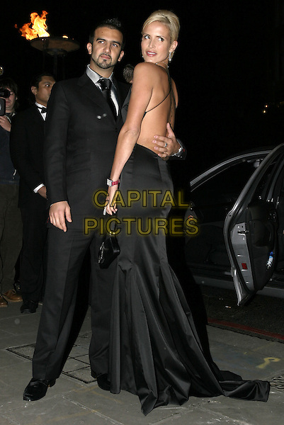 MARK & SOPHIE ANDERTON.At La Dolce Vita Ball in association with UNICEF,.Old Billingsgate, London, December 13th 2004..full length, couple, black dress designed by Kiri, silver diamante trim, plunging neckline, low cut, boyfriend, girfriend, .Ref: AH.www.capitalpictures.com.sales@capitalpictures.com.©Capital Pictures.
