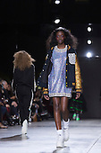17 February 2014, London, England, UK. A model walks the runway at the Ashish show during London Fashion Week AW14 at the Topshop Show Space/Tate Modern.