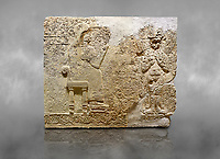 Hittite relief sculpted orthostat stone panel  of Long Wall Limestone, Karkamıs, (Kargamıs), Carchemish (Karkemish), 900-700 BC. Anatolian Civilisations Museum.<br /> <br />  The hieroglyphics reads; &quot;I am Win-a-tis, beloved wife of my Lord Suhi, wherever and whenever my husband honours his name, he will honour my name as well with favours&quot;. Underneath, there are two goddess figures, one is naked with a horned head, holding her breasts with her hands. Her genitalia is indicated by a triangle. <br /> <br /> On a grey art background.