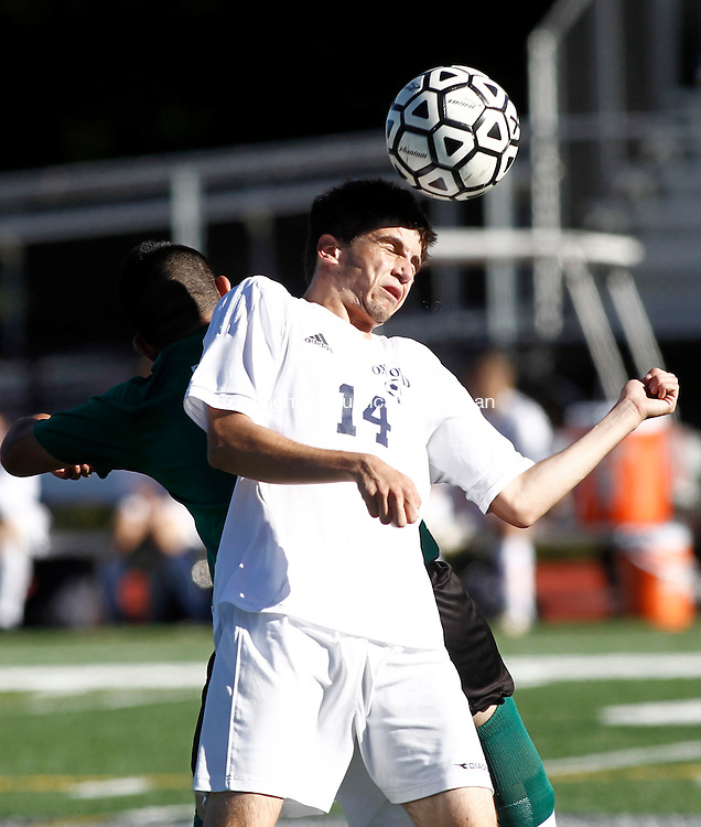 Oxford, CT- 22 September 2014-092214CM08- Oxford's Joshua Selgado heads the ball away from Wilby's Donoban Tipantuna during their NVL matchup  Monday. Christopher Massa Republican-American
