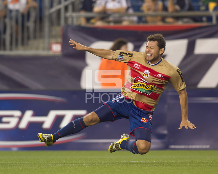 Monarcas Morelia forward Miguel Sabah (9) takes a dive in the penalty area earning him a second yellow, red card ejection. Monarcas Morelia defeated the New England Revolution, 2-1, in the SuperLiga 2010 Final at Gillette Stadium on September 1, 2010.
