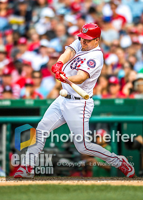 29 June 2017: Washington Nationals first baseman Adam Lind hits a pinch hit single in the 7th inning against the Chicago Cubs at Nationals Park in Washington, DC. The Cubs rallied against the Nationals to win 5-4 and split their 4-game series. Mandatory Credit: Ed Wolfstein Photo *** RAW (NEF) Image File Available ***