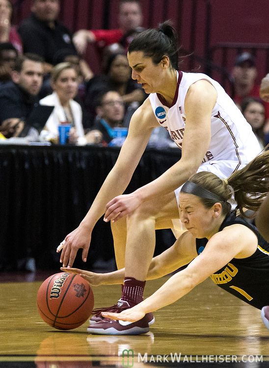 Missouri guard Lianna Doty and Florida State guard Leticia Romero scramble for a loose ball during the first half of a second-round game of the NCAA women's college basketball tournament in Tallahassee, Fla., Sunday, March 19, 2017. (AP Photo/Mark Wallheiser)