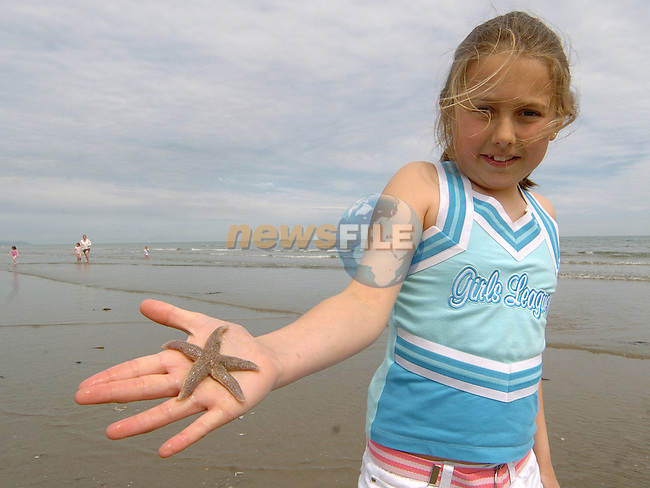 Melissa Kelly from Galway collecting starfish on Bettystown beach yesterday..Photo: Colin Bell / Newsfile