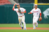 Buffalo Bisons third baseman Jim Negrych #5 throws to first as Ryan Goins #3 looks on during the second game of a double header against the Lehigh Valley IronPigs on June 7, 2013 at Coca-Cola Field in Buffalo, New York.  Lehigh Valley defeated Buffalo 4-0.  (Mike Janes/Four Seam Images)